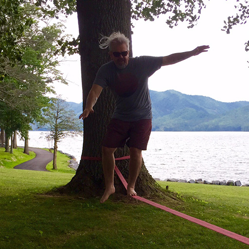 Photograph of Brian slacklining beside a Lake